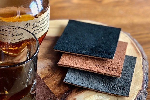 Products by Pingree displayed with whiskey.