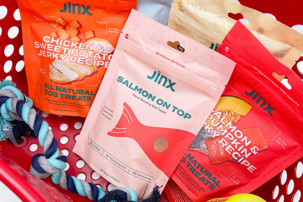 JINX dog food bags with dog toys in a Target shopper.