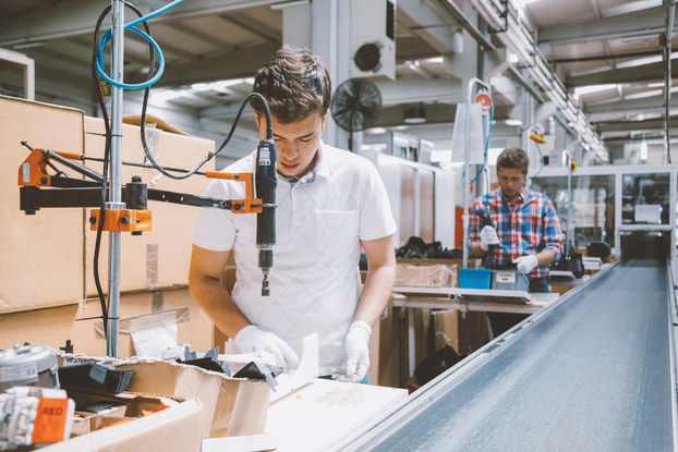 Employees working on production line in a factory.
