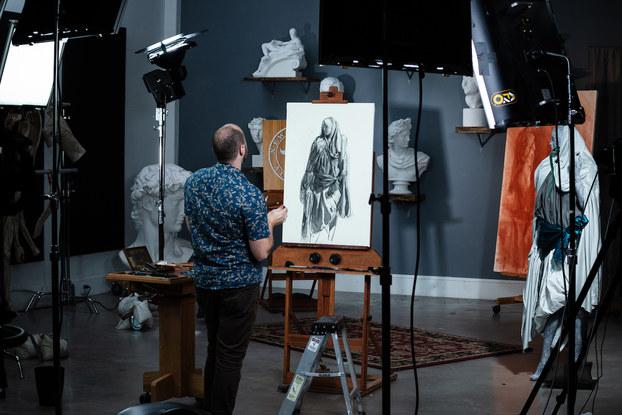 New Masters Academy instructor Iliya Mirochnik filming an art class.