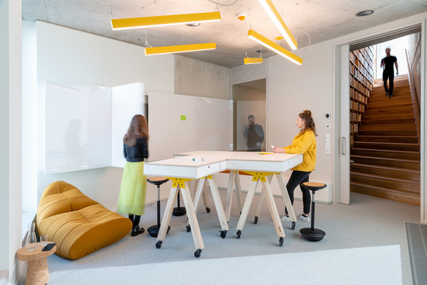 Interior of Alcon Lighting, with a desk and employees.