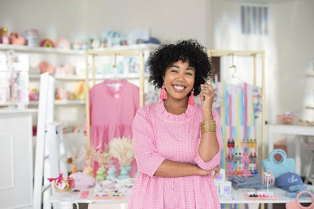 Mimi Striplin, founder of The Tiny Tassel, posing in her shop.