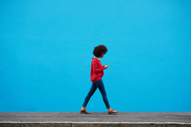 woman walking while on smartphone