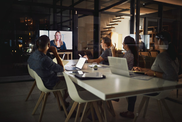 people having video conference at a table