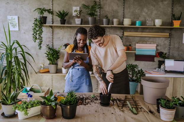 two florists using tablet