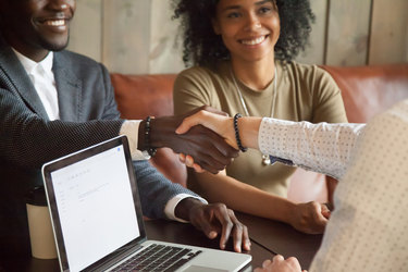 Business lender shaking hands with entrepreneur