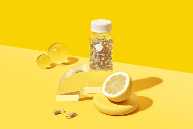 product display of ritual vitamins with yellow backgound