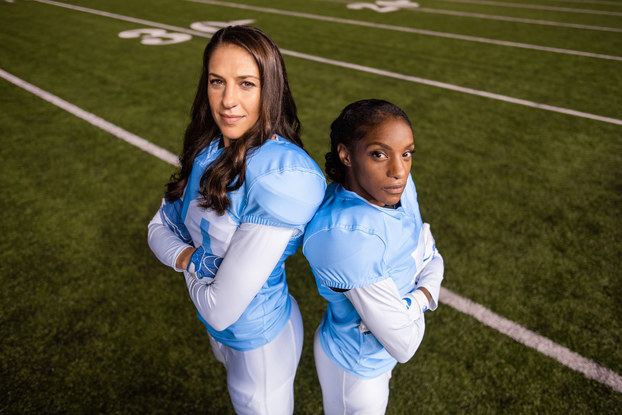 two women dressed up as football players