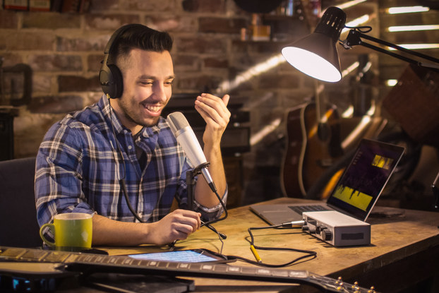 man recording podcast at home