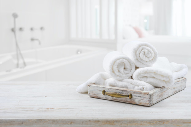 towels rolled up in white bathroom