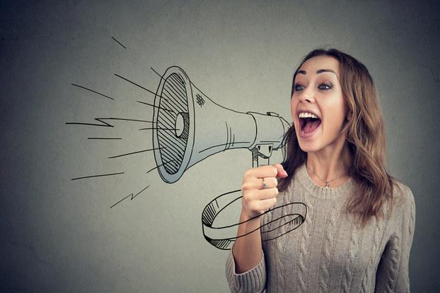 Woman yelling through bullhorn