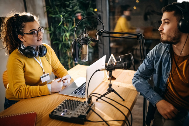 two people recording an interview