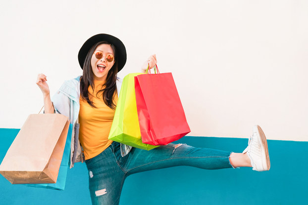 happy woman holding shopping bags