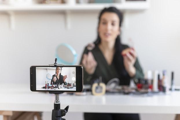 woman live streaming makeup