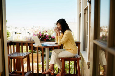 woman sitting outside with laptop