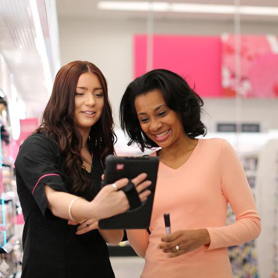 Walgreens employee helping female customer