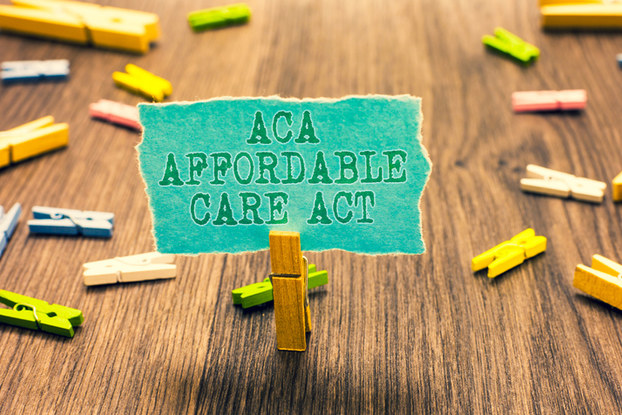 affordable care act sign with wooden clips