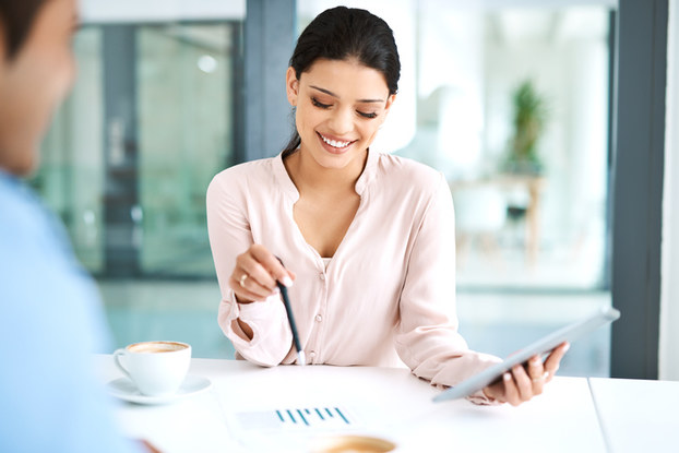 woman going over marketing plans with tablet