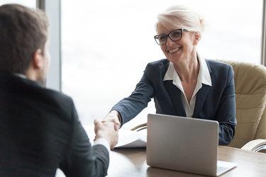 man meeting with woman at a bank