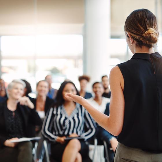 professional woman giving presentation
