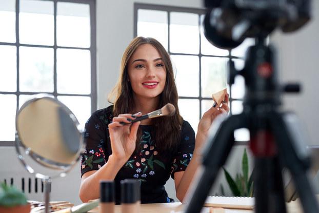 female influencer recording makeup tutorial