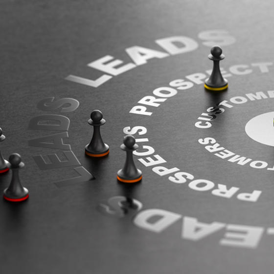 chess pieces on a table with words about prospects and leads
