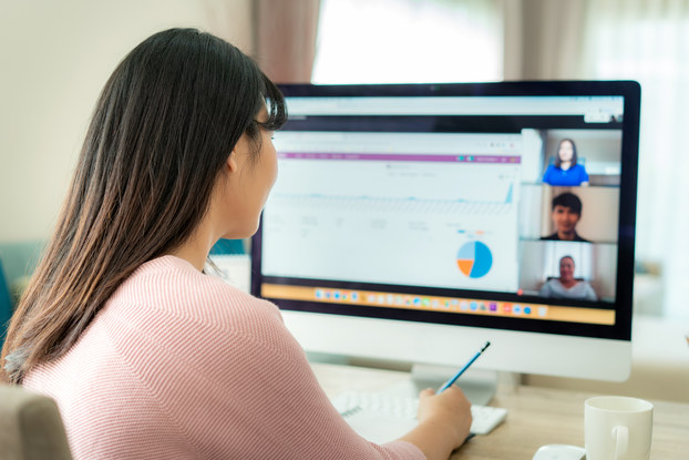 woman on videoconference with coworkers
