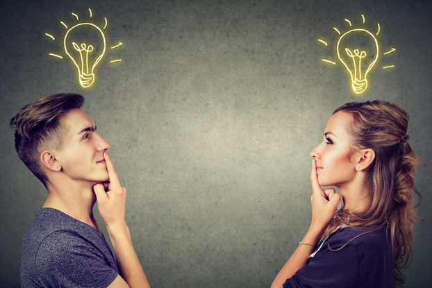 man and woman brainstorming ideas