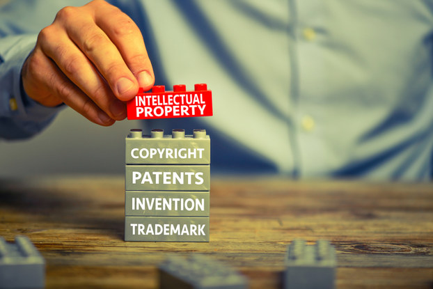 building blocks with words about patents and trademarks