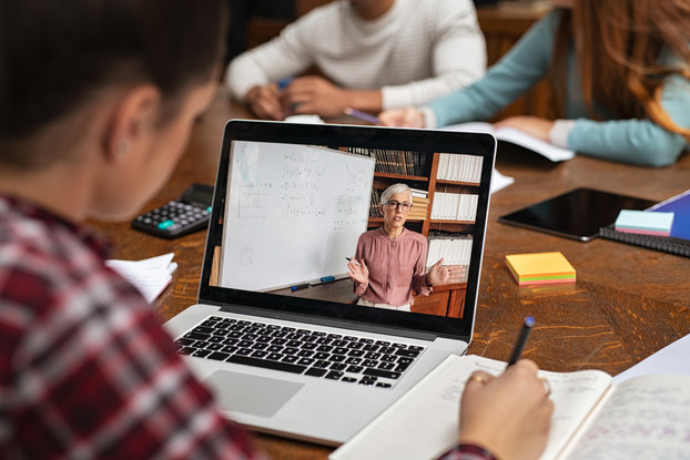 man watching virtual event on laptop