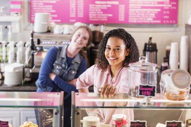 Workers behind restaurant counter