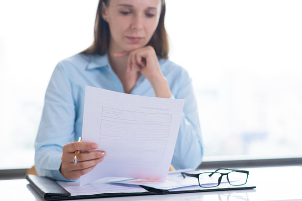 professional woman looking over a document