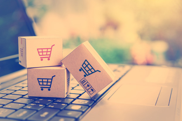 small blocks displaying shopping carts on top of a laptop