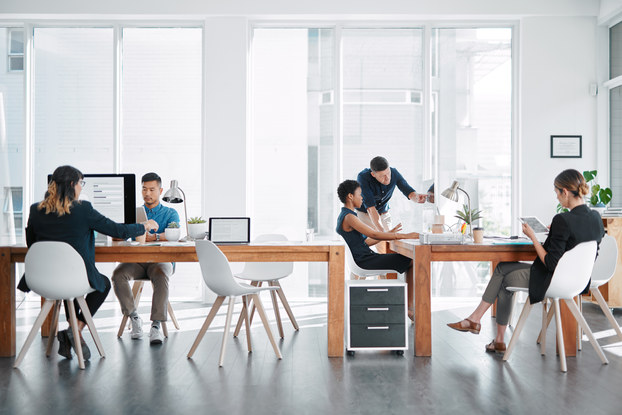 coworkers in a bright office space