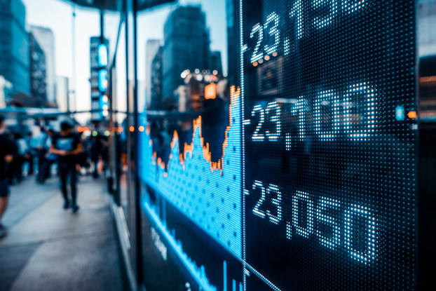 image of stocks on digital board on the street