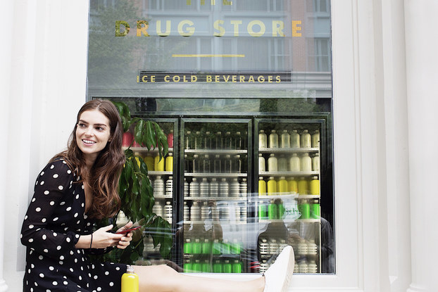 woman sitting outside the drug store location with dirty lemon drink