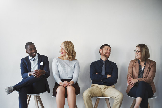 four candidates sitting waiting for job interview