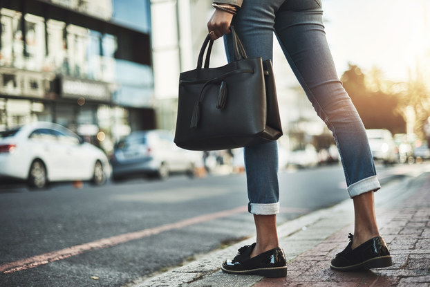 woman walking with purse on street