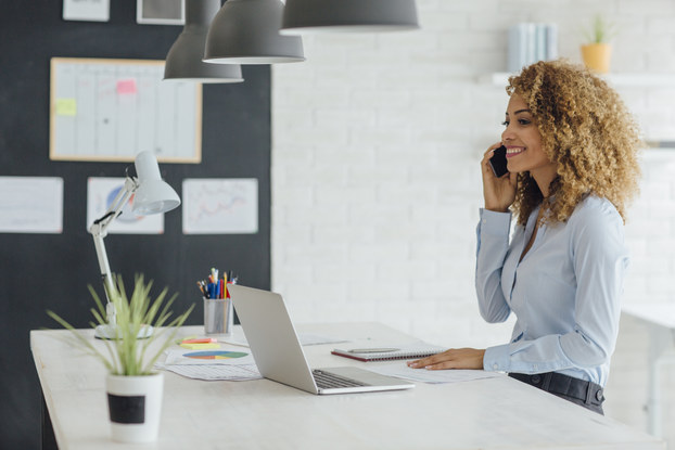 woman working in office on phone
