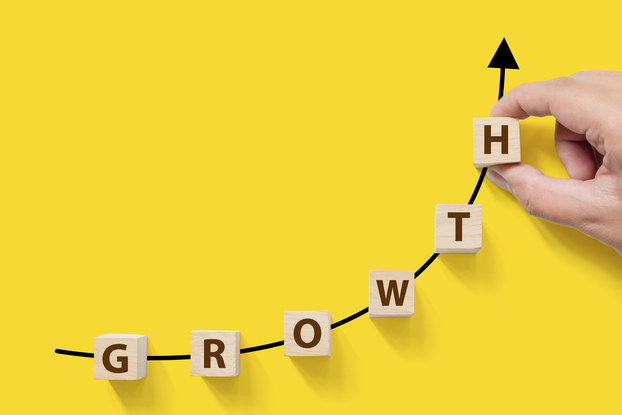 the word growth in block letters on yellow background