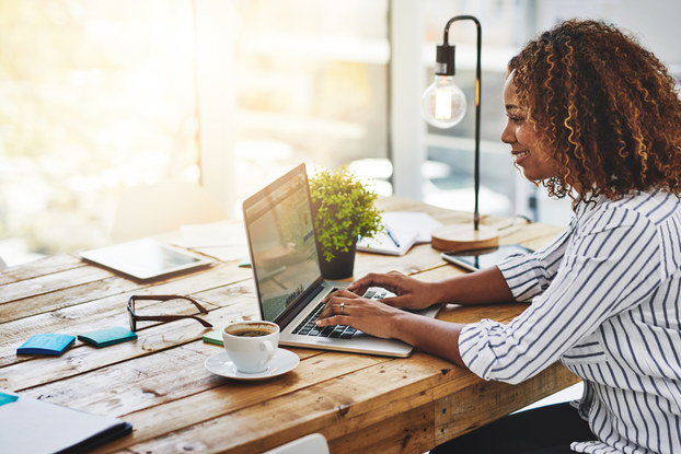 woman sitting at desk on laptop