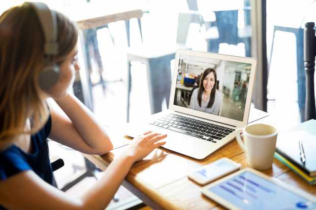 woman web conferencing on laptop