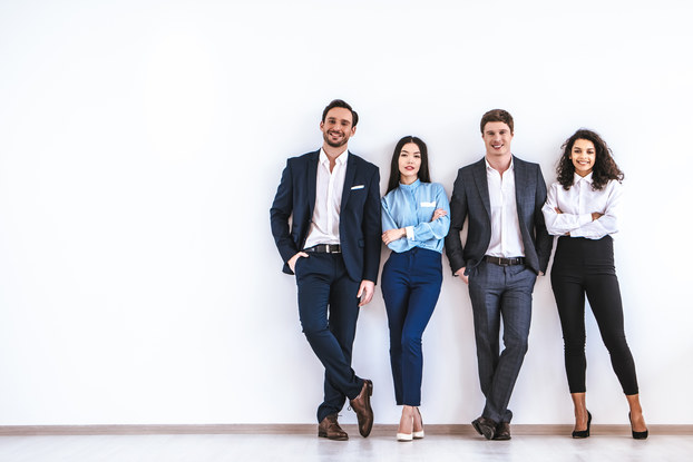 four business people standing in a row