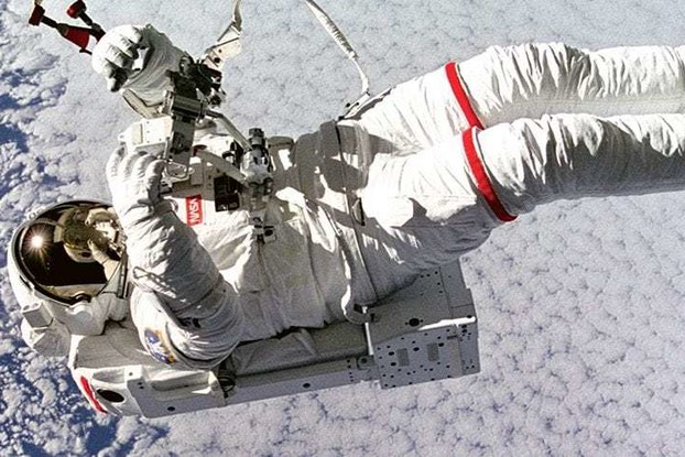 Astronaut floating in space NASA technology