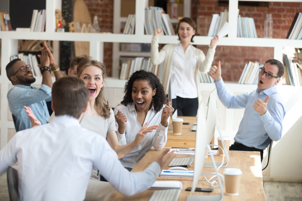 group of coworkers receiving good news