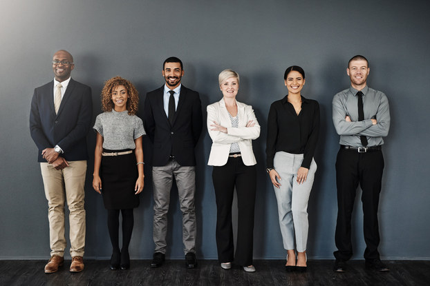 group of coworkers standing in a line