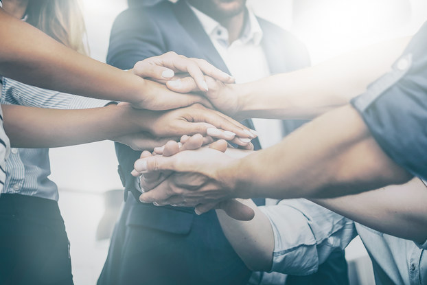 employees stacking their hands in a circle
