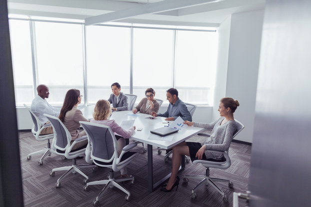 employees sitting in a board meeting