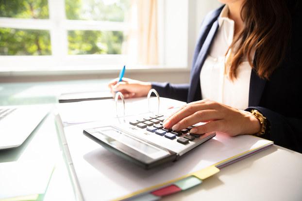 woman working on calculator
