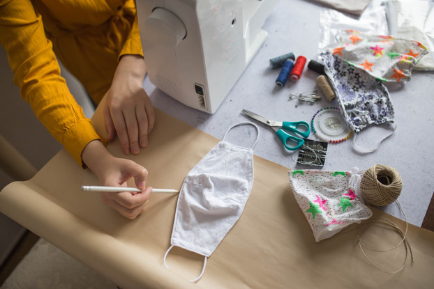 person sewing face masks